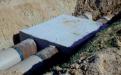 TRANS - Verbindung von GFK- und Stahlrohr mit unterschiedlichen Außendurchmessern bei den Zu- und Abläufen einer Verteilkammer.